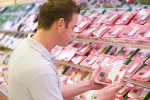 man choosing meat at grocery store